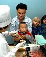 Health worker collects blood samples from children (World Bank Photo Collection) Tags: girls man boys children parents blood europe child father testing medical parent health doctor needle sample medicine nurse clinic centralasia kazakhstan collect worldbank testtubes