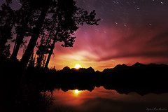 The Golden Hour of Night (Dylan MacMaster) Tags: reflection tree silhouette night clouds stars moonset sawtoothmountains littleredfishlake fotocompetitionbronze thepinnaclehof kanchenjungachallengewinner tphofweek135