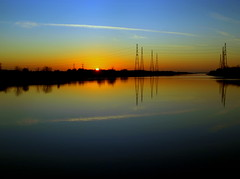 The River Ribble can look beautiful at times (Tony Worrall Foto) Tags: city sunset sun reflection wet water beautiful beauty weather river photo colours northwest image horizon stock scenic lancashire shade preston pylons tones shimmer settingsun lancs electri riverribble prestondocks ashtononribble prestonian 2012tonyworrall prestonmarinacolor linesc
