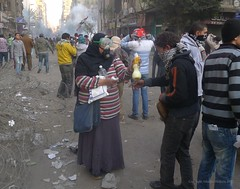 A woman treats protesters for eye soreness and other effects of tear gas. Mohamed Mahmoud Street, Cairo, 4th February 2012.