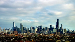 Skyline  -- Explored (yooperann) Tags: sky chicago west skyline architecture clouds buildings day skyscrapers cloudy side metropolis neighborhoods chicagoist