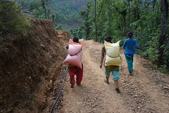 We brought a truckload of 30 kg rice each for 150 families, these young girls would carry it on their back with ease (PsJeremy) Tags: nepal rice girlpower carrier burden
