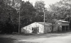 Old Garage  Newtown Pike (matthew.vortex) Tags: blackandwhite abandoned monochrome rural kentucky garage coated 1949 argus cintar c3 asa100 kentmere