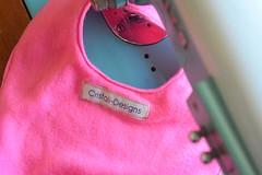 Baby bib (Cristali Designs) Tags: pink girls home project living soft sewing crafts bib creative wip fabric present fleece ideas manualidades costura babybib babero cristalidesigns