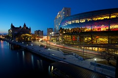 Downtown Ottawa (Perry McKenna) Tags: longexposure glass beautiful canon iso100 downtown ottawa bluehour westinhotel rideaucanal chateaulaurier conventioncentre lightstreak 10sec 1740l edgy conferencecentre f13 day337 11123 colonelby day337365 5dmk2 mackenziebridge shotat17mm 3652011 365the3511edition