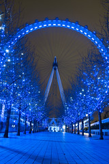 Leading to the Eye above London (Jonathan.Russell) Tags: christmas blue trees light brick london eye wheel metal canon pretty bokeh pavement ferris walkway stunning pillars pathway 40d