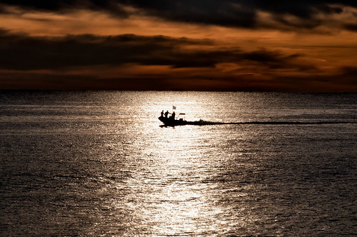 sea seascape nature silhouette sunrise boat flag military dramatic mission biot lightray redclouds