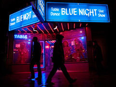 misdirection, blue night // sankt pauli, hamburg (pamela ross) Tags: street blue red silhouette pen germany walk hamburg olympus stpauli redlightdistrict passerby contrejour ep1