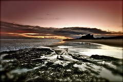 Dawn breaks over Bamburgh Castle (petelovespurple) Tags: pink seaweed silhouette dawn nikon sigma northumberland 1020mm bamburgh bamburghcastle d90 petee