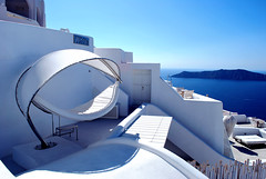 White Hotel Santorini (Jeka World Photography) Tags: world above travel blue sea sky sun sunlight white jeff water beauty rose concrete outdoors greek photography volcano hotel bed inn nikon europe mediterranean day balcony cement aegean tranquility nopeople kind patio santorini greece caldera tropical coastline sensuality greekislands viewpoint idyllic vacations oia hotelroom stucco mediterraneansea thira archipelago cot tranquilscene jeka d60 traveldestinations jeffrose cycladesislands buildingexterior highangleview mediterraneanculture pastelcolored touristresort aegeanislands builtstructure coastalfeature jekaworldphotography jeffrosephotography kalitharosephotography whitehotelsantorini