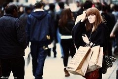 Shopping (Rick Nunn) Tags: red portrait london shopping head candid photojournalism rick bags nunn canonef135mmf2l