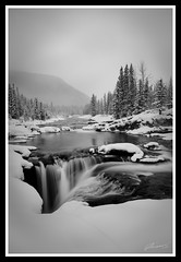 Elbow Falls (Denis Plechkov) Tags: longexposure winter blackandwhite bw snow canada cold december fuji sigma alberta 1020mm canmore elbowfalls 2011 s5pro