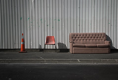 cone chair couch (ghostofrapaki) Tags: road street camera new old sunset red christchurch urban orange white st fence point landscape earthquake chair iron suburban cone sony a33 couch zealand vignette lanscape slt 2012