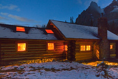 Glowing Lights of Elizabeth Parker Hut in Yoho National Park (Lee Rentz) Tags: windows light chimney mountain snow canada heritage history nature stone night lights evening log cabin warm glow snowy britishcolumbia interior lodging meadow warmth peak structure historic lodge hut logcabin northamerica glowing lamps shelter snowfall inviting accomodation yoho welcoming lakeohara canadianrockies yohonationalpark alpinehut subalpine wiwaxypeaks alpineclubofcanada elizabethparkerhut federalheritagebuilding