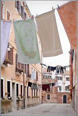 Rita Crane Photography:  Italy / Venice  / Castello / laundry / Everyday Venezia, East Castello (Rita Crane Photography) Tags: venice italy buildings pastel stock clothes laundry clothesline dailylife cheerful residences stockphotography typicalscene everydayvenice ritacranephotography wwwritacranestudiocom eastcastello