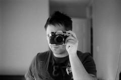 OM10 and the Rare Selfie (Josh_Wolf) Tags: portrait bw film self 35mm photo olympus om10 roll1 zuiko kentmere film:iso=100 ilfordilfosol3 developer:brand=ilford developer:name=ilfordilfosol3