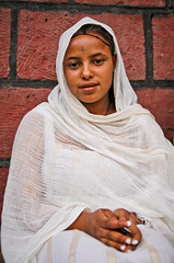 Ethiopian girl in Lalibela. (NeSlaB .) Tags: poverty africa portrait girl tattoo canon easter religious photo eyes women dress traditional faith prayer religion jesus clothes celebration holy christianity ethiopia orthodox rite pilgrim rites developingcountries reportage lalibela pilgrims holyweek fasika amhara neslab