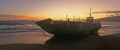 sunset and the beast (bluewavechris) Tags: ocean sunset sea sky sun mountain beach mike water coral clouds army island volcano hawaii boat sand navy maui shipwreck medium landingcraft lcm