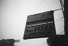 sam's pizza, san francisco (ho_hokus) Tags: sanfrancisco blackandwhite bw beer sign restaurant lomo lca lomolca hamburgers pizza 35mmfilm signage cocacola sams kodakgold400 samspizza filmphotographypodcast elementsorganizer sanfrancisco2011