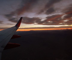 Window view... () Tags: sunset vacation sky orange holiday southwest yellow clouds plane airplane fly inflight dusk aircraft altitude flight wing jet aerial windowview boeing winglet merrychristmas latitude rtw aereo airliner vacanze avion happynewyear 737 southwestairlines wingtip windowseat roundtheworld hny globetrotter airplanewing  areo jetwing boeing737 worldtraveler  ario  southernnevada  12312011