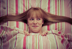 Bed bug (The Green Album) Tags: girl horizontal bug hair bed warm long pillow duvet giggling snuggled