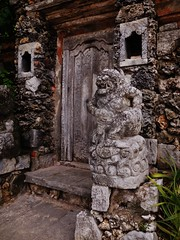 a Balinese entrance (SM Tham) Tags: bali beach statue coral indonesia outdoors island asia doors entrance stonecarving textures step villa walls residence guardian woodcarving sanur niches