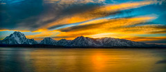 Fire in the Sky (Lynleigh Cooper) Tags: travel blue sunset vacation sky panorama orange usa mountain lake snow mountains color reflection love nature water colors beautiful beauty clouds america landscape photography landscapes photo nationalpark amazing nikon colorful peace photographer gorgeous awesome scene panoramic best serenity stunning serene wyoming lovely peaks naturalbeauty nationalparks traveler photooftheday grandtetonnationalpark natureshot tranquill landscapephotography mountainsunset mountainphotography bestoftheday