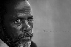 One eye...one lens...one vision (MRK Clicks) Tags: life street old portrait bw man eye face look accident streetphotography chennai eyelid oneeye mrk parrys mrkclicks damagedeyelid