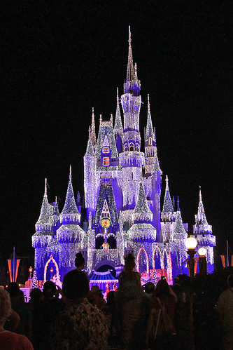 disney world castle decorated for christmas