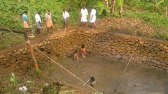 Cleaning (Binoy Marickal) Tags: pond kerala mala kulam catchingfish binoy kuzhur marickal