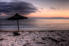 Ofrinio (Vasilis Mantas) Tags: sunset sea bw art beach umbrella photography 110 greece macedonia nd hdr kavala touzla ofrinio ofrynio