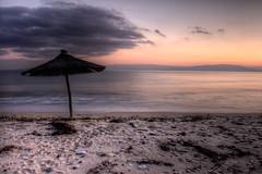 Ofrinio (Vasilis Mantas) Tags: sunset sea bw art beach umbrella photography 110 greece macedonia nd hdr kavala touzla ofrinio ofrynio