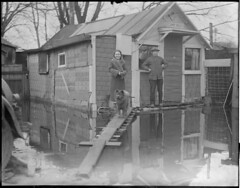 Man, woman, and dog outside cabin Camp Rest during New England flood (Boston Public Library) Tags: weather storms floods lesliejones