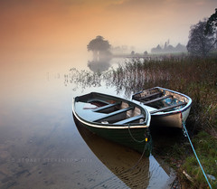 Moored (Stuart Stevenson) Tags: uk morning autumn trees mist water sunrise reeds boats photography dawn scotland freezing wideangle serene loch wellies warmlight stirlingshire lochard clydevalley canon1740 nohorizon kinlochard scottishloch canon5dmkii stuartstevenson illuminatedfog