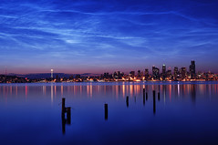 Noctilucent Clouds Over Seattle (David M Hogan) Tags: seattle reflection water skyline night clouds sunrise dawn downtown cityscape waterfront alki spaceneedle pugetsound pilings elliottbay noctilucent