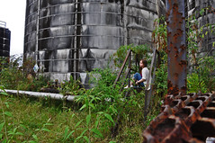 Peaceful Solitude (pinkandpurpledaisies) Tags: wild selfportrait me overgrown girl weeds solitude industrial alone peace silo pensive tumbledown pipeline ruined contemplation project365