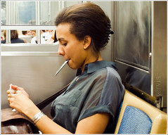 Earbuds, iPod & Banana Clip on the ride home (TheeErin) Tags: people woman chicago public train subway hands ipod cta publictransportation authority el il busy transportation transit bracelet both l commuter redline seated rider occupied humans distracted earbuds chicagotransitauthority chicagoist ridership masstrans bothhandsoccupied