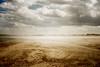 somewhere (.ultraviolett) Tags: lighting light sea sky film beach clouds 35mm diary analogue dust olympusmjuii