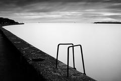 Clontarf Seafront (2) (Ger208k) Tags: blackandwhite dublin seascape bay fineart seawall le silence ladder seafront clontarf graduatedfilter bestminimalshot bigstopper gerardmcgrath