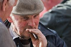 On the quiet (Frank Fullard) Tags: street ireland portrait horse irish galway cigarette candid secret smoke fair hidden cap smoker sly ballinasloe woodbines fullard frankfullard