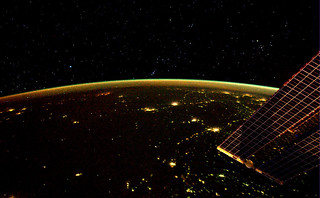 The Earth by night and the Orion constellation