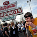 A runner grimaces as he lays into a doughnut.
