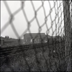 Sandsfield Lane Over the Tracks (tatraskoda) Tags: old uk england urban bw history 120 6x6 tlr film monochrome mediumformat geotagged mono town blackwhite lomo railway line lincolnshire lubitel2 analogue ilford fp4 gainsborough twinlensreflex commiecamera sandsfieldlane