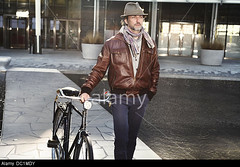 DC1MDY (derosadaniela) Tags: city urban man male hat leather bicycle scarf walking person one living three clothing holding thought day looking with view adult o go transport away front jacket walkway only pensive quarter casual leisure years length 35 39 mid contemplation utdoors