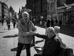 Reluctance (Leanne Boulton) Tags: life street city uk light shadow portrait people urban blackandwhite bw sunlight white man black detail male men texture monochrome face look canon mono scotland living blackwhite hands eyecontact faces arm natural emotion humanity outdoor expression glasgow candid culture streetphotography streetlife wideangle scene human shade 7d posture feeling gesture society depth tone facial gripping interaction reluctance candidstreetphotography candideyecontact