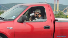 Tough Texan Breakfast (Halcon122) Tags: red dog cute breakfast sanantonio candid streetphotography bexarcounty
