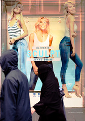 unveiled (Toky, Lily and George moments) Tags: fashion contrast downtown dummies veil streetphotography jeans shopwindow juxtaposition niqab timing cultureclash oppositesides headturning culturalcontrast morethana1000words