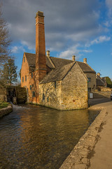 The Mill, Lower Slaughter, Gloucestershire (Geraldine Curtis) Tags: chimney reflection cotswolds gloucestershire redbrick themill lowerslaughter cotswoldstone