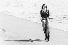 Cycling (Suicidal_zombie) Tags: bw girl monochrome beautiful bicycle stpetersburg island bright russia sunny saintpetersburg embankment russie      vasilyevskiy leutenantschmidt