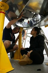 "Vy and John install the cooling strap for the main science camera • <a style=""font-size:0.8em;"" href=""http://www.flickr.com/photos/27717602@N03/27309646712/"" target=""_blank"">View on Flickr</a>"